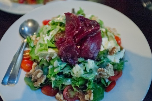 Colleen's Beet Salad with fresh organic Kula greens, organic grape tomatoes, candied walnuts and goat cheese.