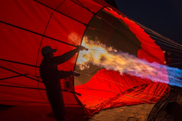 Filling the balloon with hot air in the pre-dawn.