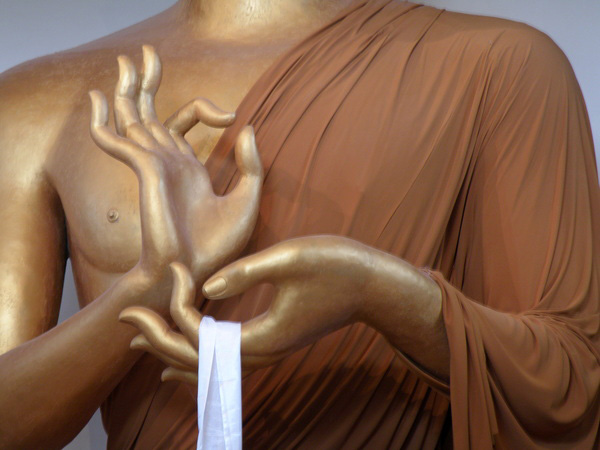 Hands of Buddha at Stupa of Dharmakaya, photo by lestermore