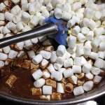 mini marshmallows into melted ingredients