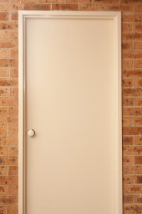 Image of White Door in Brick Wall | Freebie.Photography