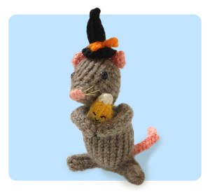Knitted Mouse wearing a tiny witch hat