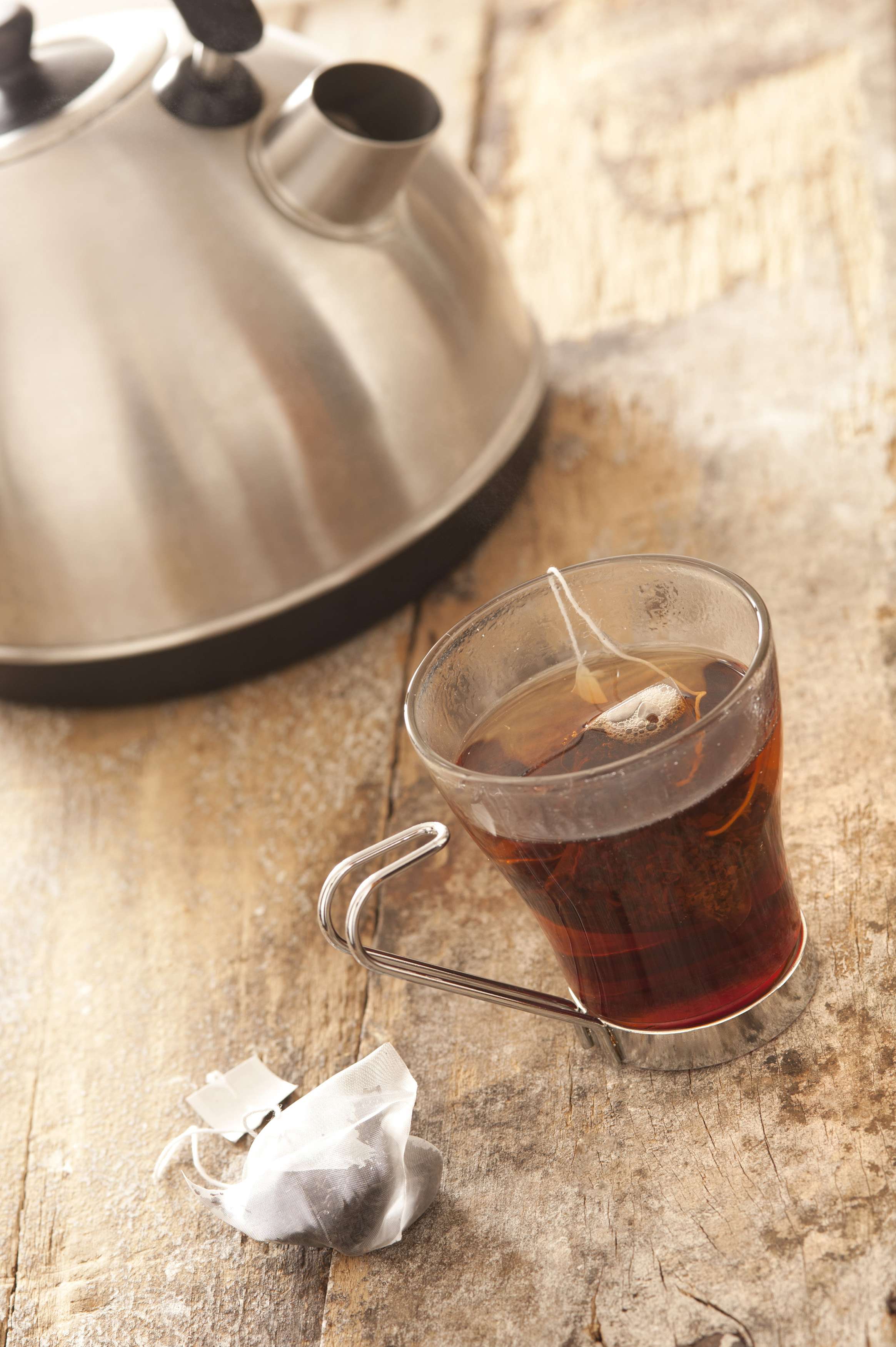 Making Tea In A Teapot Mug Of Tea Brewing On Table Beside Kettle Free Stock Image