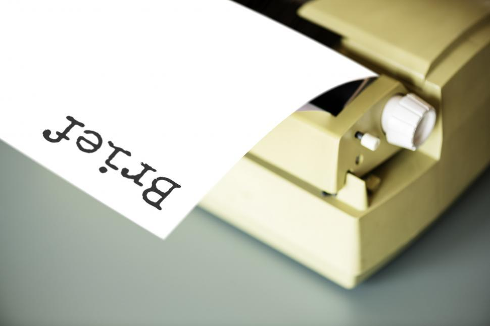 Get Free Stock Photos of Close up of a paper coming out of a