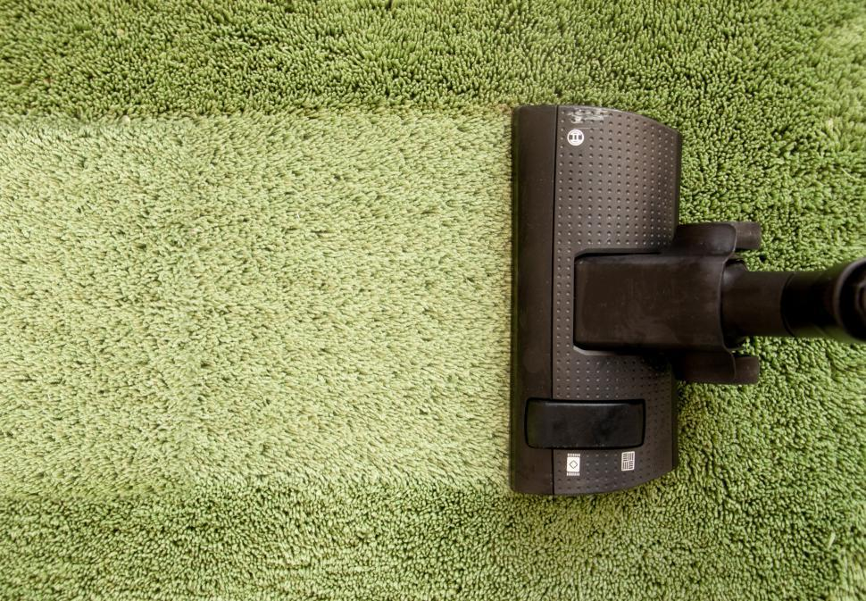 Get Free Stock Photos of vacuum cleaner on carpet cleaning Online