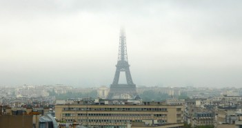 Eiffel Tower disappearing in the clouds © French Moments