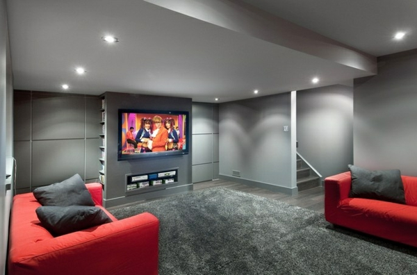 This remodeled basement includes an entertainment wall and a cozy