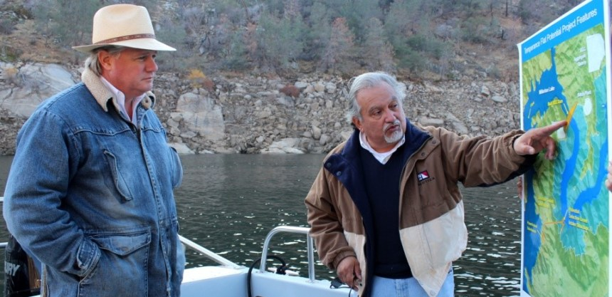 The San Joaquin Valley's newest State Senator, Andy Vidak (left) sees the site of the proposed 1.2 million acre-foot Temperance Flat Reservoir's dam in the upper end of Millerton Lake. Vidak (R-HANFORD) listens as Friant Water Authority Assistant General Manager Mario Santoyo explains how the reservoir, development of which could benefit from a state water bond as it now stands, would operate.