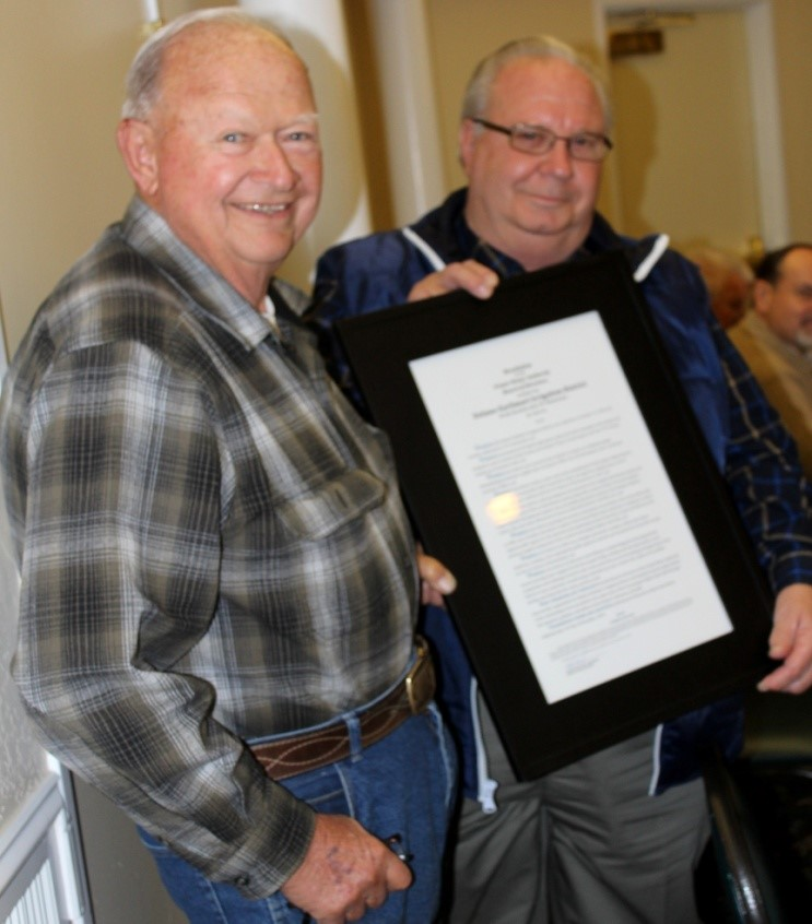 Friant Water Authority / J. Randall McFarland A framed resolution honoring the Delano-Earlimart Irrigation District is presented by FWA Chairman Harvey Bailey (left) to Nick Canata, DEID board member.