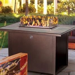 Kozy Heat Northern Flame outdoor fireplace table available in gas or propane looks with a hidden propane tank compartment.
