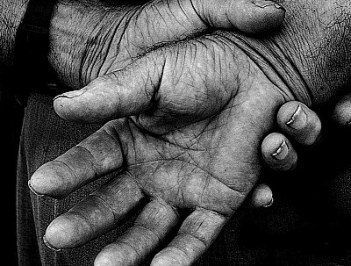 The youth cleaned his mother's hands..His tear fell as he did that. It was the first time he noticed that his mother's hands were so wrinkled slowly.