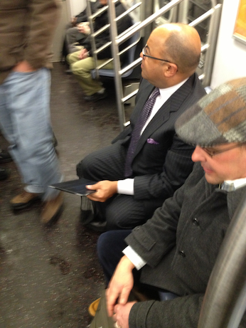 Mike Tirico rides the subway between 