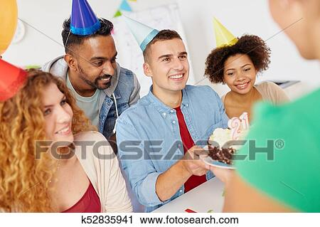 Team greeting colleague at office birthday party Stock Photography