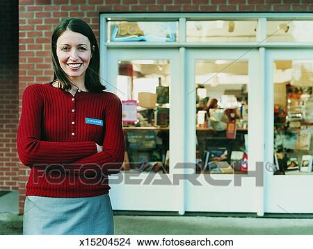 Stock Photo of Portrait of a Smiling Shop Assistant Standing Outside