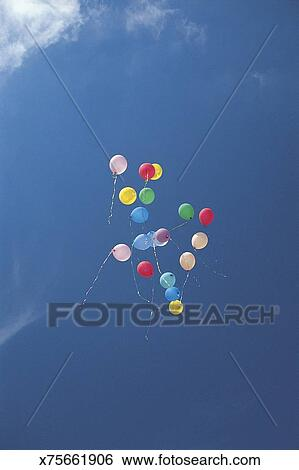 Stock Images of Balloons floating in sky x75661906 - Search Stock
