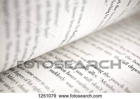 Stock Photograph of Text on the pages of an open book, extreme close