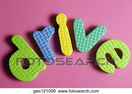 Stock Photograph of Close-up of alphabets spelling the word drive - word alphabets