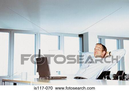 Stock Photography of Businessman relaxing in office is117-070