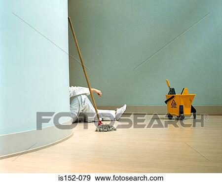 Stock Photograph of Cleaner relaxing in office is152-079 - Search
