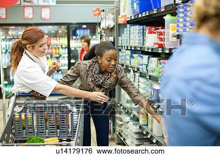 Stock Images of Female shop assistant helping customer u14179176 - shop assistan