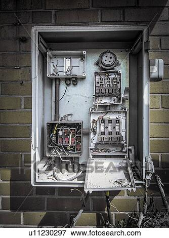 Picture of Disused fuse box on wall of abandoned industrial building