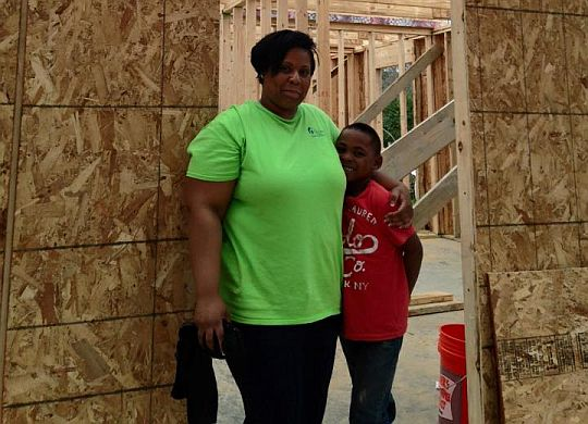 Amish volunteer team raises walls on Ginger Ford Northshore's 24th new home