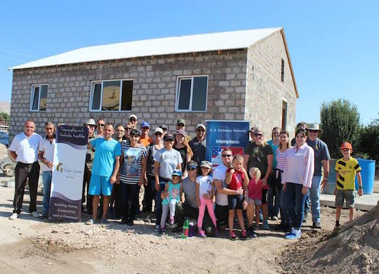 PHOTO GALLERY: U.S. Embassy employees work on Armenian home to commemorate 9/11