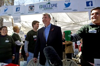 Ed Gillespie, center, greets guests during the 66th annual Shad Planking in Wakefield Wednesday afternoon.