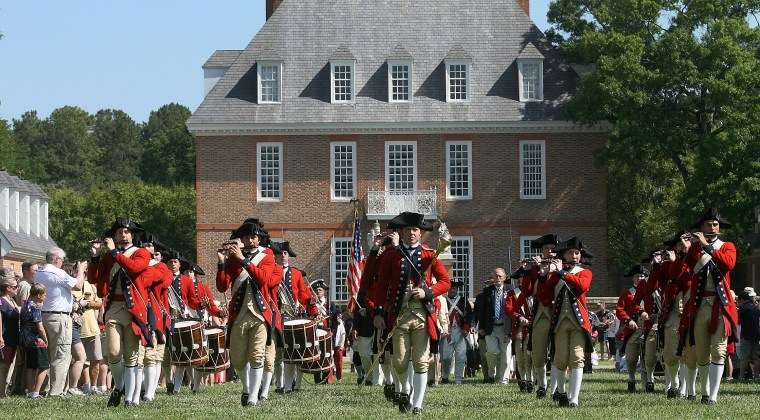 The Colonial Williamsburg Fifes and Drums parade on down the lawn in front of the Governors Palace in Williamsburg Monday during a Memorial Day ceremony to honor veterans killed during the American Revolution. (Photo By Rob Ostermaier)