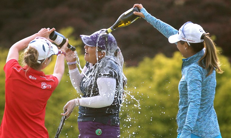 Lizette Salas is doused with wine after winning the Kingsmill Championship Sunday. Salas was 13 under for the tournament.