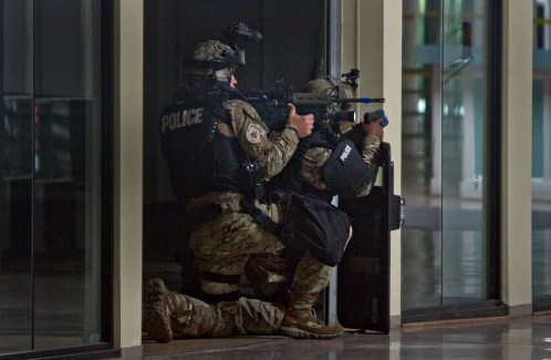 Members of the James City County tactical team run through an active shooter scenario inside the closed Williamsburg Outlet Mall Tuesday. Tactical teams from Newport News, Hampton, James City Police, York-Poquoson Sheriff's Dept.