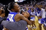 Hampton's Malia Tate-DeFreitas, left, and Bayley Coleman-Cox, center, celebrate after defeating Coppin State 50-47 during Saturday's championship game of the 2014 MEAC tournament at Norfolk Scope Arena.
