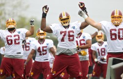 Redskins tackle Morgan Moses (76) warms up Thursday during the first day of training camp in Richmond. (Photo by Rob Ostermaier)