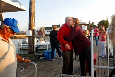 Inez Pruitt, right, hugs goodbye Dr. David Kemp Thursday evening. Dr. Kemp visits Tangier island every other week to treat patients at the Riverside Tangier David B. Nichols Health Center, where Pruitt is a physician's assistant. (Jonathon Gruenke)