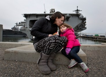 Brittney Marshall and Amelia 2 waited for hours for the USS Theodore Roosevelt to deploy Monday.
