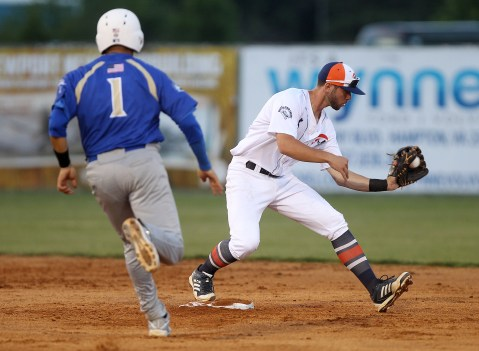 Pilot's Luke Toms makes the catch at second getting Holly Springs' Tony Davila out at second during the third inning Wednesday at War Memorial Stadium.
