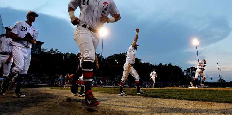 The Peninsula Pilots take the field during the third inning against Holly Springs Wednesday at War Memorial Stadium.