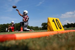 Heritage's Jeremiah Boyd throws the ball during the opening day of football practice Thursday afternoon.