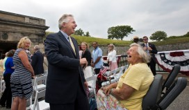 """Gov. Terry McAuliffe greets Fort Monroe resident Marguerite Stankus prior to a deed signing ceremony for the transfer of lands to the National Park Service on Tuesday at Fort Monroe. Stankus said she was pleased to see the area receive recognition. """"If it's a joint effort to preserve this place for a long time, then we've accomplished what we need to accomplish,"""" she said. """"It's a remarkable place if you just take the time to look at it—there's no other place in the whole world like it."""""""