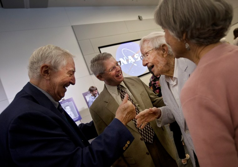 Duncan McIver, left, congratulates Langley Research Center NACA and NASA Hall of Honor inductee John Becker, 101, second from right, following the conclusion of a ceremony on Thursday at NASA Langley. (Kaitlin McKeown)