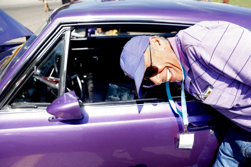 Dave Grandinett of Williamsburg smiles while reaching inside his 1968 Plymouth Barracuda during Saturday's Southern Fried Festival at Langley Speedway. The event featured a barbecue competition, car show and live music.