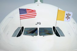 JOINT BASE ANDREWS, MD - SEPTEMBER 22: The papal flag and the U.S. flag fly from the cockpit of Pope Francis' airplane after it arrived from Cuba September 22, 2015 at Joint Base Andrews, Maryland. Francis will be visiting Washington, New York City and Philadelphia during his first trip to the United States as Pope. (Photo by Chip Somodevilla/Getty Images)