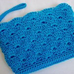 Turquoise Rippled Shells Clutch w/ strap $15.00