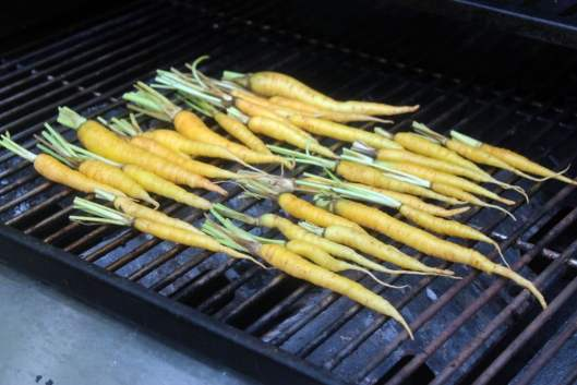 Start carrots on grill
