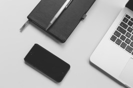 Phone, notebook, book and pen