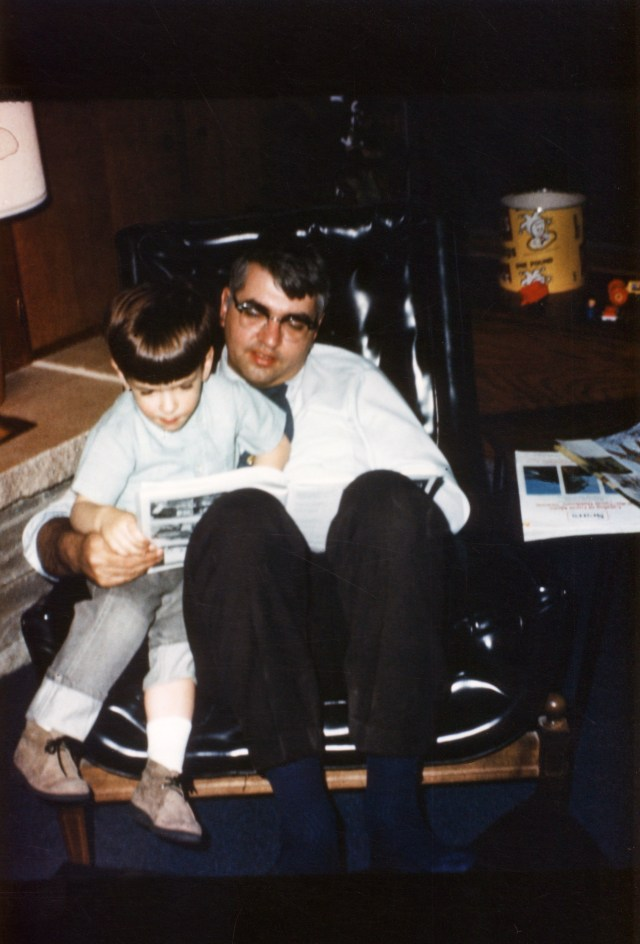 Dad reading to me after work when I was about three years old