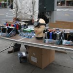 Street vendor cashing in selling flashlights in Lower Manhattan