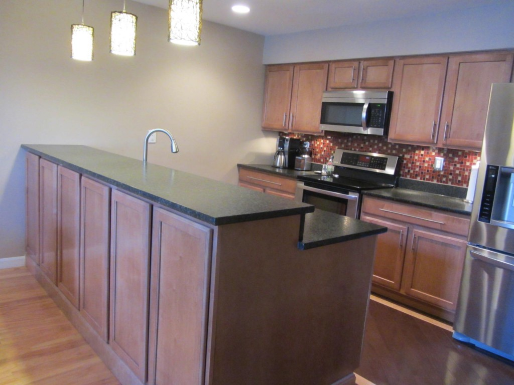 kitchen features split level kitchen remodel Kitchen remodel with upper cabinets for extra storage Remodeled kitchen with bi level