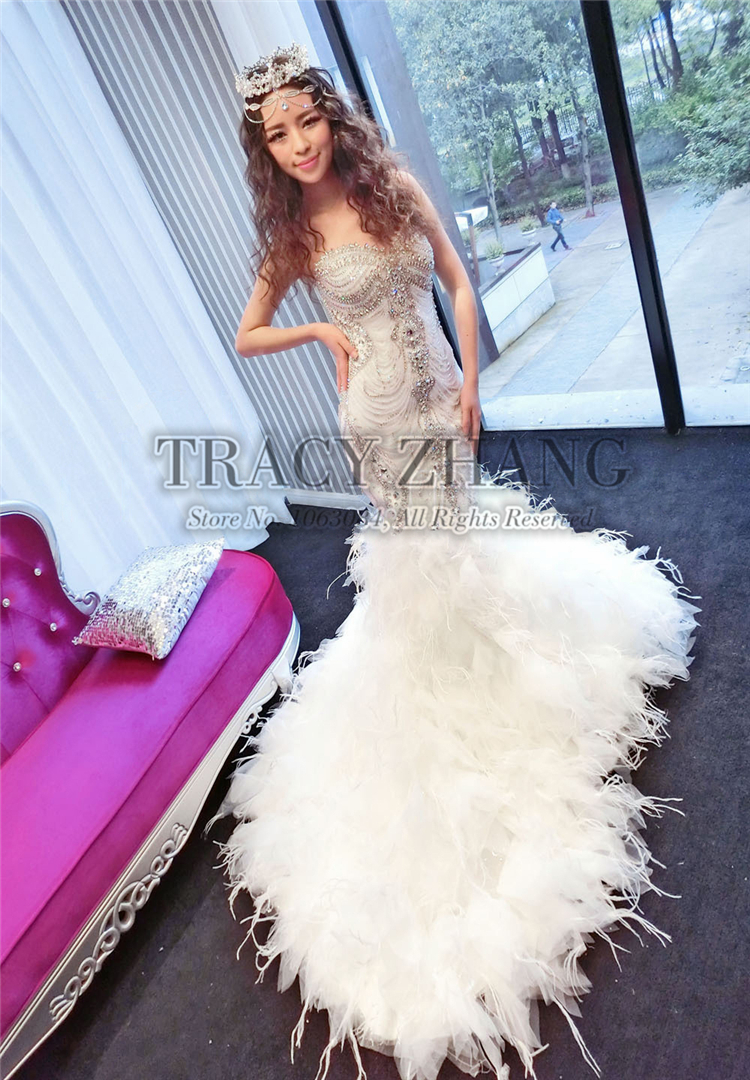 great gatsby wedding feathered wedding dress Sparkly dress with feathered skirt by Sue Wong image by Taken by Sarah Photography