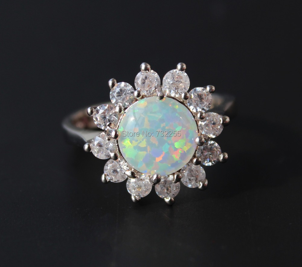 opal wedding rings Gorgeous 10K Black Gold Victorian Gothic Rainbow Topaz and Fire Opal Ring Now available